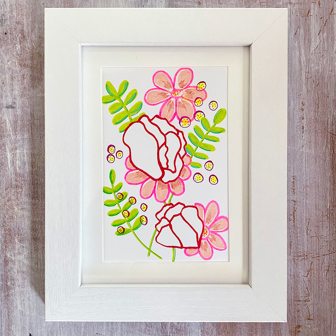 3.5x5.5 drawing in white frame of deep pink and peach and flowers with green ferns on white paper.